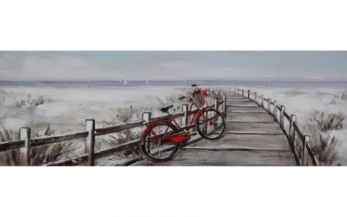 Cuadro de bici roja en la playa